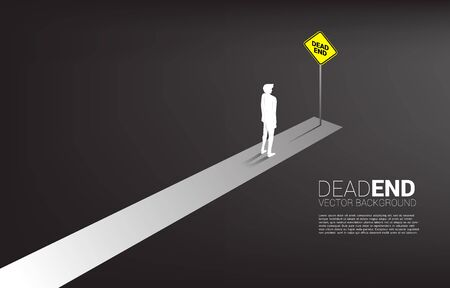Silhouette businessman standing at the end of road with dead end signage. Concept of wrong decision in business or end of career path. Ilustração