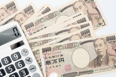 Close up calculator on japanese currency yen money banknote. Background concept for japan economy.