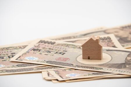 Close up little wooden house on japanese currency yen money banknote. Background concept for japan  real estate industry economy.