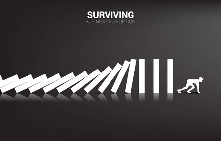 surviving business disruption. Silhouette of businessman ready to run away from domino collapse. Concept of business industry disrupt