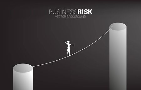 Silhouette of businesswoman walking on rope walk way to higher bar chart.Concept for business risk and career path