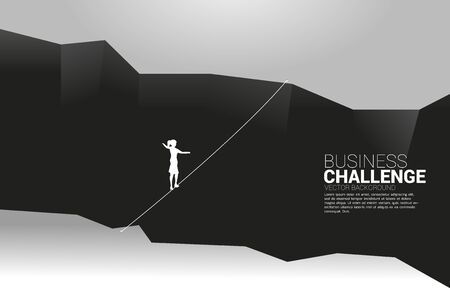 Silhouette of businesswoman walking on rope walkway.Concept for business risk and challenge in career path Çizim