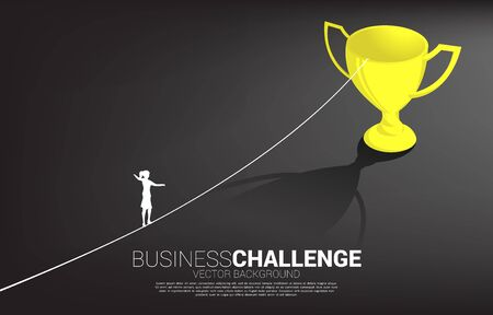 Silhouette of businesswoman walking on rope walk way to golden trophy .Concept for business risk and career path