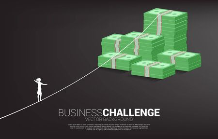 Silhouette of businesswoman walking on rope walk way to money banknote stack .Concept for business risk and career path