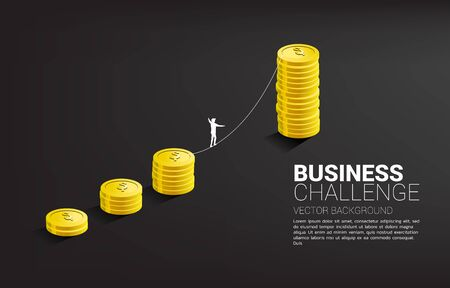 Silhouette of businessman walking on rope walk way to golden coin stack graph .Concept for business risk and challenge.