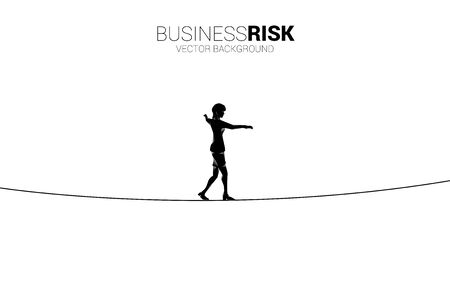 Silhouette of businesswoman walking on rope walk way.Concept for business risk and challenge in career path