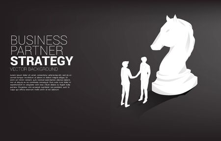 Silhouette of businessman handshake with chess piece knight. Concept of team work partnership and cooperation strategy.
