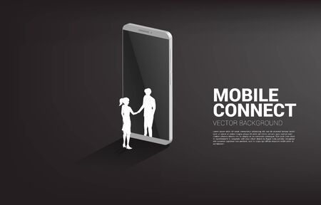 Silhouette of businessman and businesswoman handshake from mobile phone . Concept of business partnership and cooperation technology.