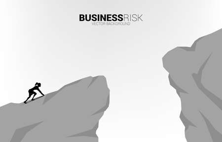 silhouette of businesswoman ready to run to jumping over the gap. concept of business challenge risk.