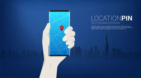 GPS pin marker and mobile phone in hand with city background. concept of location and facility place , GPS technology