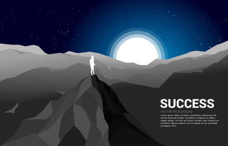 Silhouette of a businessman on top of mountain.concept of success in career and mission