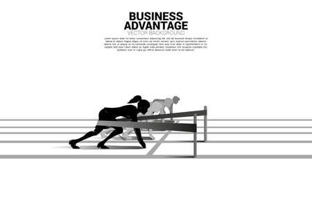Business concept of competition and business advantage. Silhouette of businesswoman ready to run from start line with catapult sling shot on racing track.