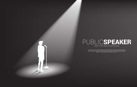 Silhouette of businessman standing with microphone. Concept of front man and public speaking.