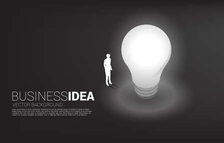 Silhouette of businessman standing with light bulb . Business Concept of creative idea and solution.