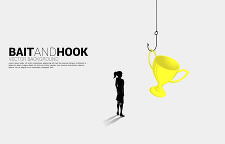 Silhouette of businesswoman standing with fishing hook with trophy. Concept of bait and hook in business rewards..