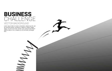 Silhouette of businesswoman jump across the wall with springboard. Concept of boost and move forward in business.