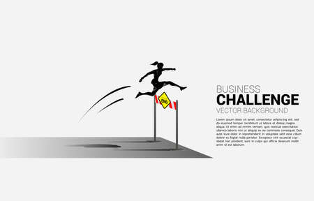 Silhouette businesswoman jumping across dead end hurdles obstacle. Background concept for Obstacle and challenge in business