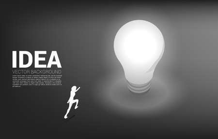 Silhouette of businessman running to light bulb . Business Concept of creative idea and solution.