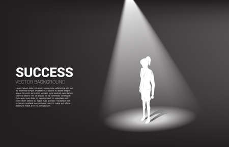 Silhouette of businesswoman standing in spotlight. business concept of mission vision and leadership