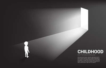 Silhouette of boy standing in front of the way out with light. Concept of education solution and future of children.