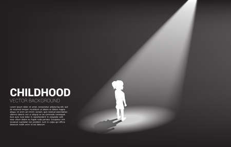 Silhouette of girl standing in spotlight. Concept of education solution and future of children.