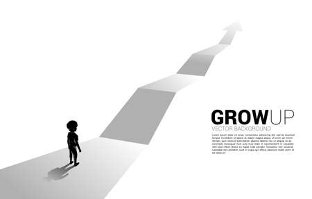 Silhouette of boy standing on route with growth arrow. Concept of education solution and future of children.