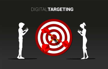 Silhouette man and woman with mobile phone with dartboard background . Business Concept of online marketing target and customer