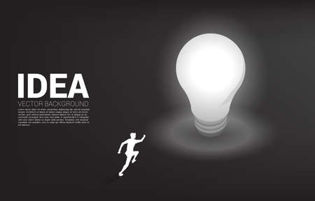 Silhouette of businessman running with light bulb . Business Concept of creative idea and solution.