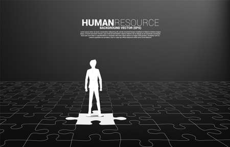 Silhouette of businessman stand on match jigsaw piece. Concept of perfect job.Team recruitment.Human Resource.put the right man on the right job. 向量圖像