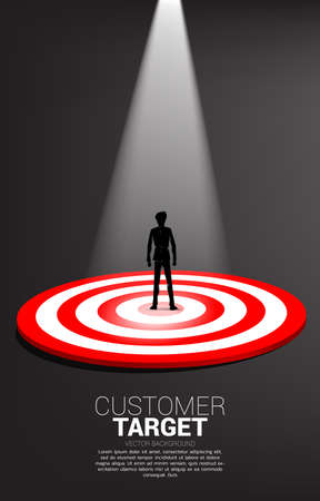 silhouette of businessman standing on center of dartboard with spot light . Business Concept of marketing target and customer.Company vision mission and goal.