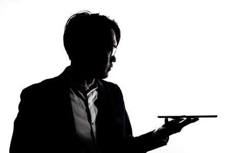 Silhouette of businessman use tablet isolate on  white background. Concept for business and online technology. Foto de archivo