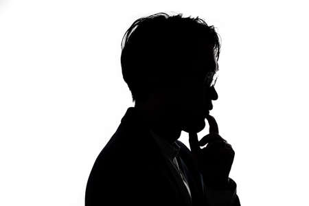 Silhouette of thinking businessman with white background. Concept for business and thinking idea. Stock fotó