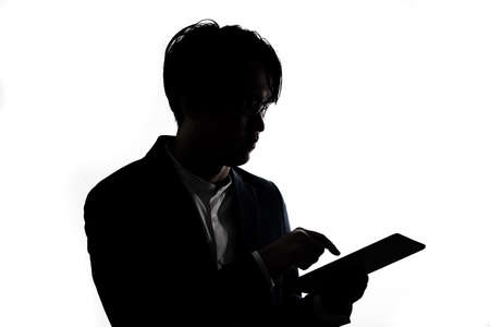 Silhouette of businessman use tablet isolate on  white background. Concept for business and online technology. 版權商用圖片 - 168361669