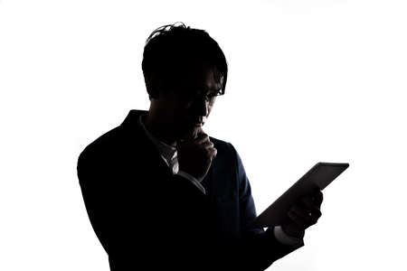 Silhouette of businessman use tablet isolate on  white background. Concept for business and online technology. Stock fotó
