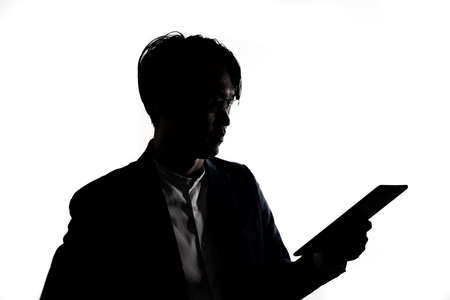 Silhouette of businessman use tablet isolate on  white background. Concept for business and online technology. 版權商用圖片 - 168361673
