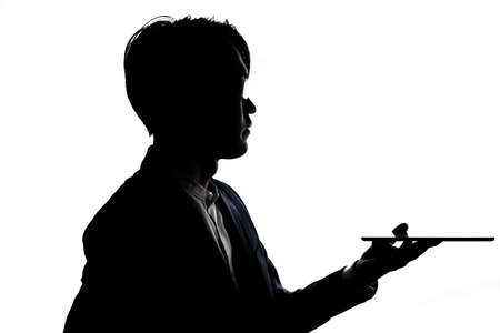 Silhouette of businessman use tablet isolate on  white background. Concept for business and online technology. Stock fotó - 168361674