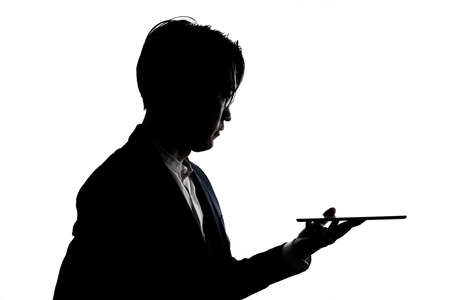 Silhouette of businessman use tablet isolate on  white background. Concept for business and online technology. Stock fotó - 168361685