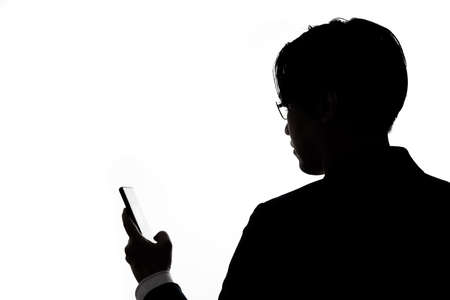 Silhouette of businessman use mobile phone isolate on  white background. Concept for business and online technology. 版權商用圖片 - 168361736