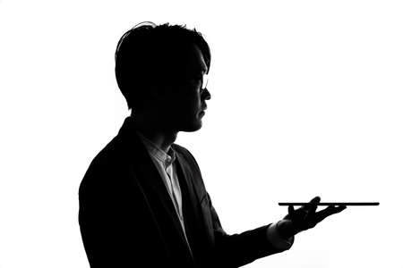 Silhouette of businessman use tablet isolate on  white background. Concept for business and online technology. 版權商用圖片 - 168361738