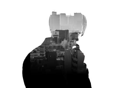 Double Exposure thinking businessman and skyscraper building city with white background. Concept for business and thinking idea.