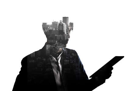Double Exposure businessman use tablet and skyscraper building city isolate on white background. Concept for business and online technology.