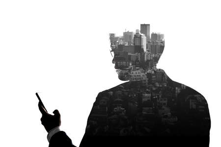 Double Exposure businessman use mobile phone and skyscraper building city isolate on white background. Concept for business and online technology.