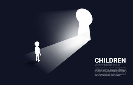 silhouette of kid ready to move out to key hole door. Concept of children education and learning.