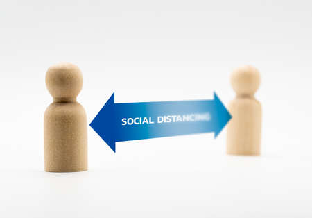 Distance between wooden human icon. Concept of social distancing and isolation.