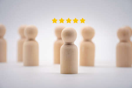 Wooden human icon with  rating star. concept for customer review and client rating rank.