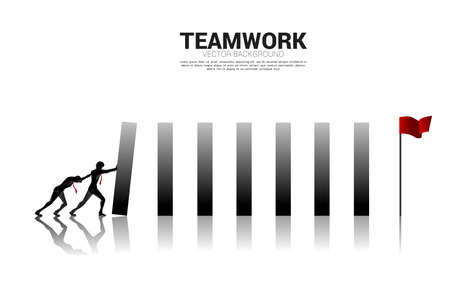 Silhouette of businessman pushing the block to create domino effect to hit the goal. business concept of try to make the domino effect