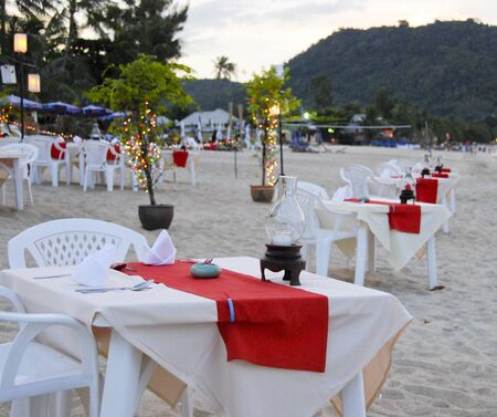 Prepared Tables on the Beach, Thailand photo