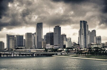 Miami Skyscrapers Exterior over a Cloudy Sky photo