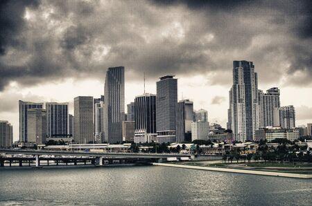 Miami Skyscrapers Exterior over a Cloudy Sky photo