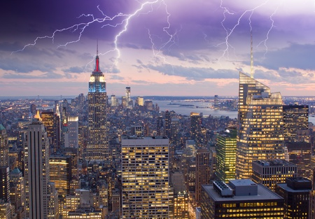 Illuminated Buildings in the Storm, New York City photo